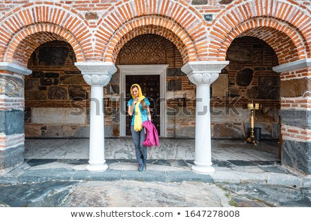 Woman entering the church on a Greek orthodox monastery Stock photo © Kzenon
