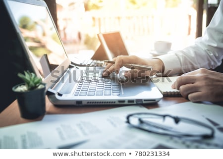 Businessman working on laptop, business concept Stock photo © ra2studio
