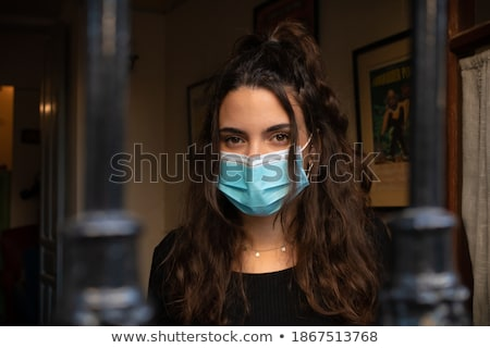 Young woman behind a grille Stock photo © fxegs