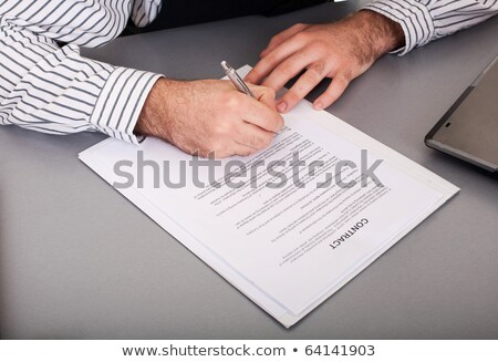 male hand siging on loan application contract on white Stock photo © vichie81