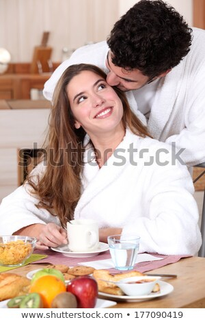 couple wearing matching bathing robes in kitchen stock photo © photography33