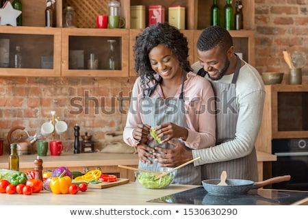 couple hugging in the kitchen stock photo © photography33