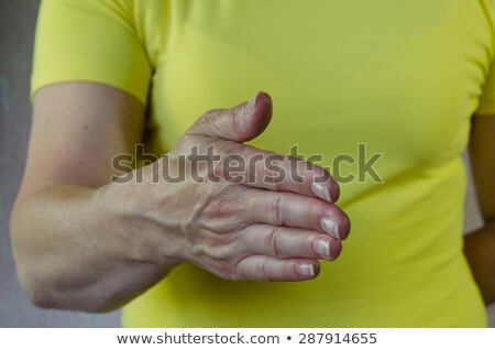 Stock photo: Business woman welcoming you with an open hand ready to shake