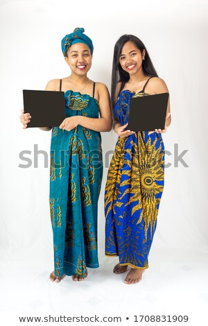two ethnic female models presenting whiteboard stock photo © stockyimages