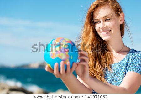 Woman in red holding planet earth Stock photo © photography33