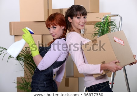 Young women cleaning out their apartment on moving day Stock photo © photography33