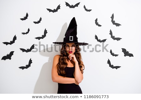 Beautiful woman in masquerade costume of witch. Stock photo © Pilgrimego