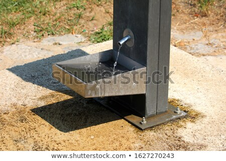 Concrete drinking fountain in park Stock photo © backyardproductions