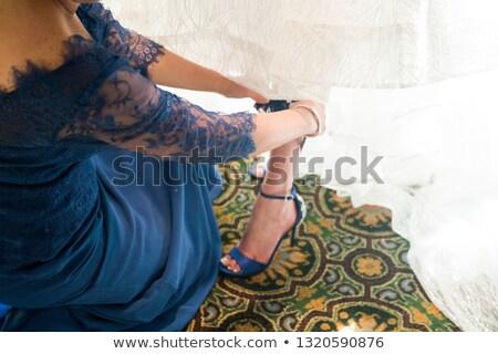 bridesmaid placing garter stock photo © iofoto