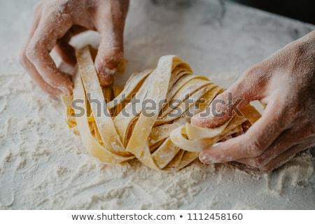 Pasta rauw voedsel Geel bruin houten kom Stockfoto © MamaMia