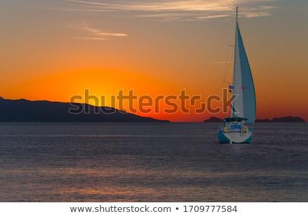 Blue orange sunset on mediterranean sea Stock photo © lunamarina