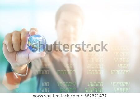 Glass earth ball on the financial chart Stock photo © leungchopan