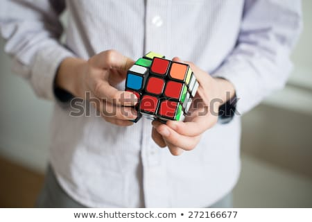 young man and cube puzzle Stock photo © nito
