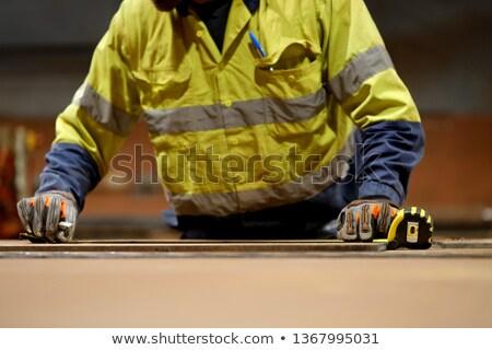 Male worker's hand holding Self-retracting tape measure meter Stock photo © stevanovicigor
