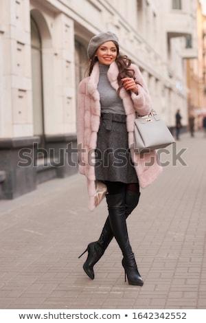 Happy brunette in winter clothes posing Stock photo © wavebreak_media