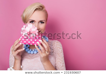 Smiling cute girl holding jewelry gift box Stock photo © deandrobot