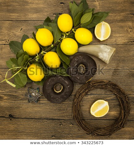 Jewish candlestick with a branch lemons  donuts and goat horn. Symbols of the great holiday of Hanuk Stock photo © mcherevan