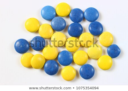 Fruit candy on the plate isolated on white. Stock photo © vapi