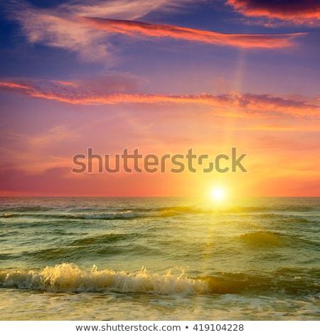 Fantastisch zonsopgang oceaan water wolken voorjaar Stockfoto © alinamd