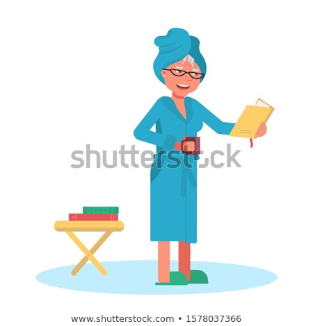 Woman in bath towel reading book at table Stock photo © dash