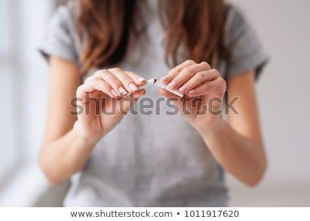Csinos nő cigaretta kép fehér póló visel Stock fotó © deandrobot