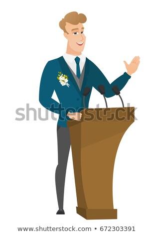 Caucasian groom giving a speech from tribune. Stock photo © RAStudio