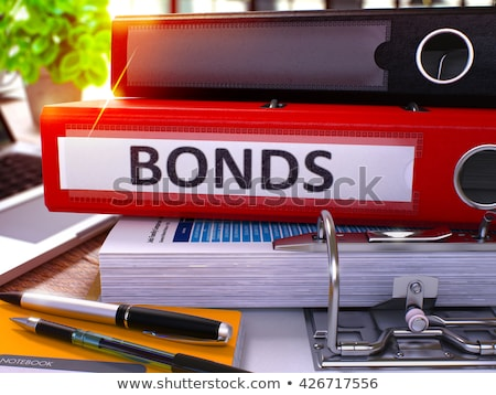 red office folder with inscription bonds stock photo © tashatuvango
