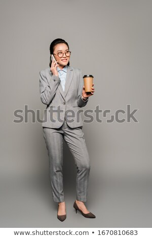 smartphone and disposable cup Stock photo © LightFieldStudios