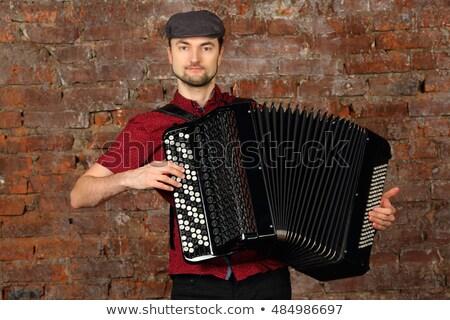 Muzikant hand spelen accordeon dramatisch Stockfoto © simply