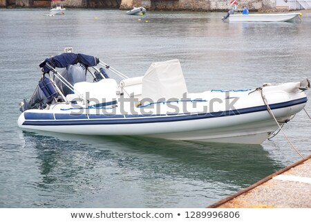 Small boat moored in harbour Stock photo © IS2