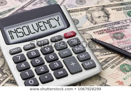 Calculator with dollar bills - Insolvency Stock photo © Zerbor