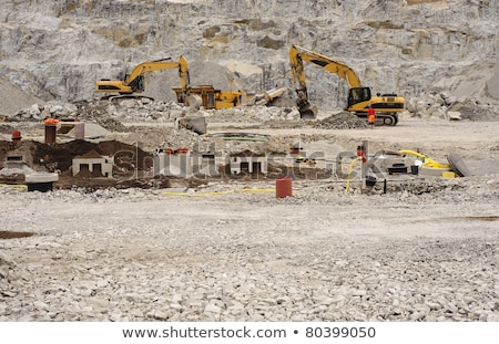 Stone Crusher machine working on road construction site Stock photo © Kzenon