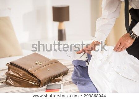 Senior Adult man unpacking clothes Stock photo © IS2