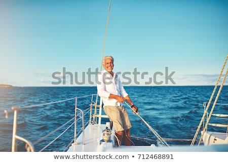 Reifer Mann Yacht lächelnd Spaß Schwimmen Freien Stock foto © IS2