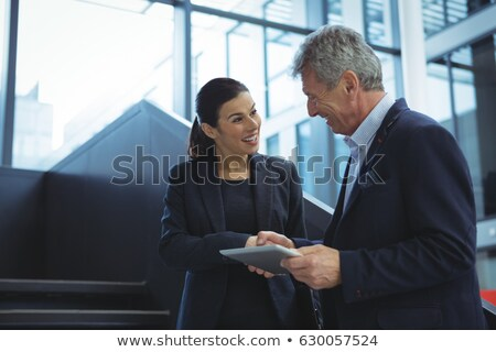 Business executives discussing over digital tablet on stairs Stock photo © wavebreak_media