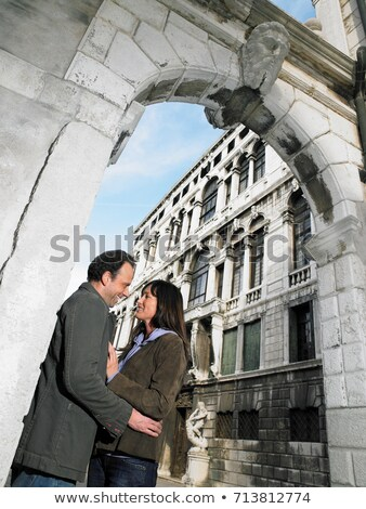 Couple embracing under stone arch Stock photo © IS2