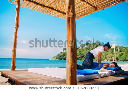 Caribbean turquoise beach massage woman Stock photo © lunamarina