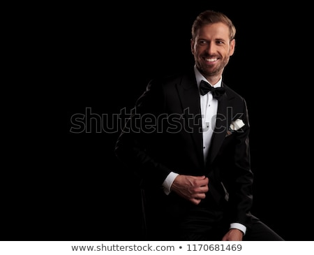 side view of laughing elegant man in tuxedo holding button  Stock photo © feedough