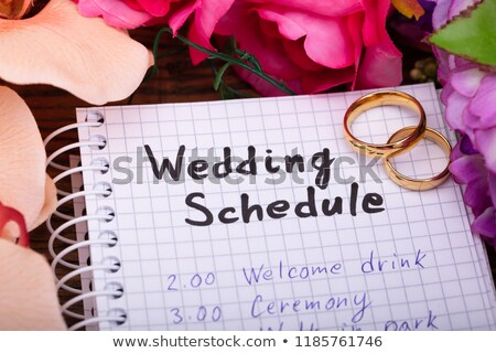 Wedding Schedule On Spiral Notepad With Golden Rings Stock photo © AndreyPopov