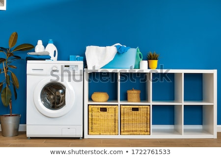 Stock photo: Laundry room with stacked washer and dryer