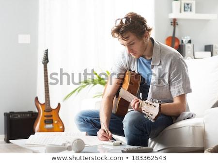 Jeunes guitariste musique fiche élégant jouer Photo stock © ra2studio