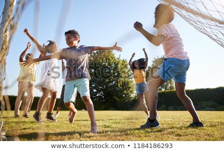 multi ethnic children playing soccer game stock photo © matimix