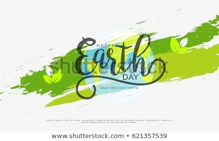 Föld napja szalag zöld bolygó levelek nemzetközi Stock fotó © cienpies