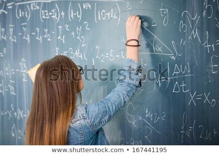 Női egyetemi hallgató iskolatábla probléma fiatal tanár Stock fotó © lightpoet