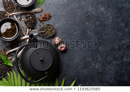 Stok fotoğraf: Various tea in spoons. Black, green and red tea