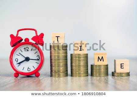 Stopwatch And Stacked Coins On Desk Stock photo © AndreyPopov