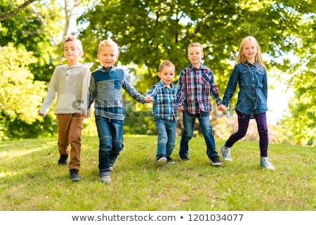Stok fotoğraf: A Group Of Children In Spring Field Having Fun