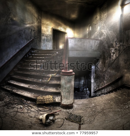 Old staircase in interior of an abandoned and ruined building Stock photo © boggy