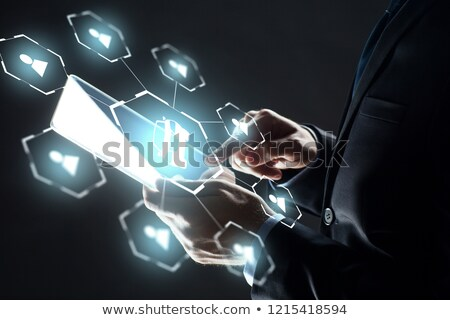 businessman with tablet pc and car sharing icons stock photo © dolgachov