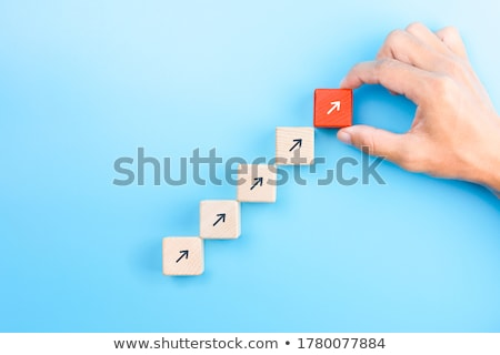 Businessman hand arranging stacking wooden blocks development as Stock photo © Freedomz
